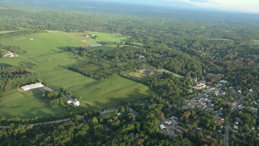Hudson Valley Late Summer aerials. UHD, 4K shots of the Millbrook area in Dutchess County, rolling green hills and horse farms, including village of Millbrook. - 4K stock video clip