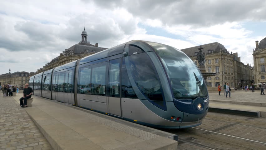 BORDEAUX FRANCE - AUGUST 2014: A modern tram departs in front of Place de la Bourse in Bordeaux France.