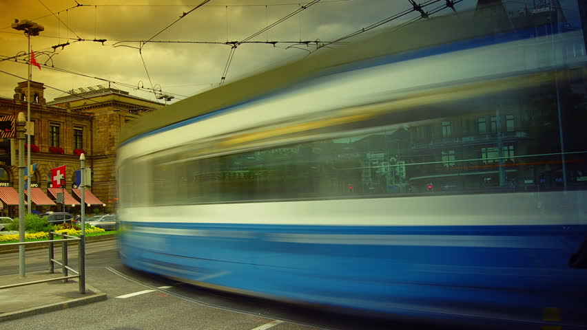ZURICH - August 17: Electric city tram moving from the main train station of the Zurich, on August 17, 2014 in Zurich, Switzerland, time lapse, 4k.