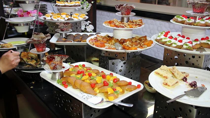 Assortment of desserts on catering buffet restaurant - Desserte table cuisine ...
