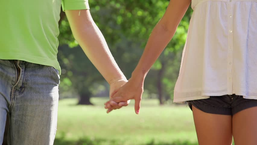 Young people in love with little girl and boy holding hands in park and walking. 5of18 - HD stock video clip