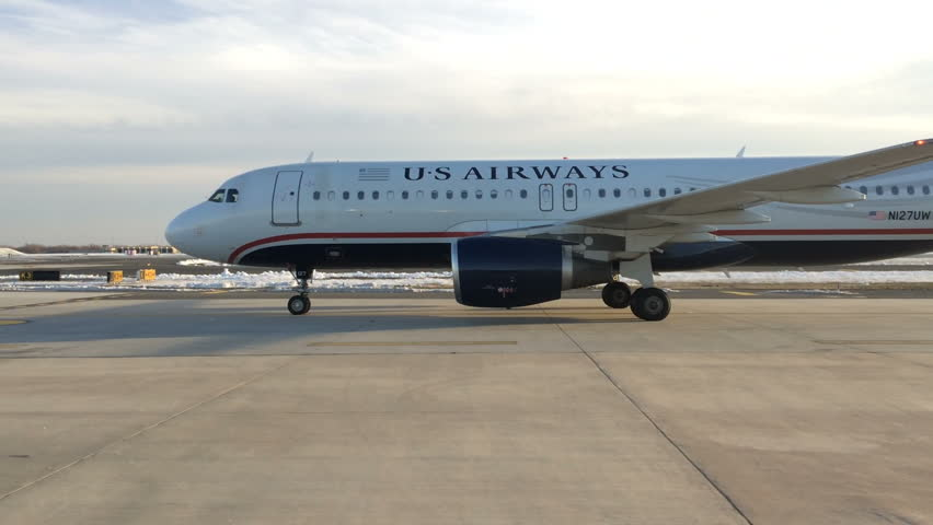 PHILADELPHIA, PA - FEBRUARY 6: US Airways airplane on runway preparing for take off at Philadelphia International Airport (PHL) on February 6, 2014 in Philadelphia, Pennsylvania.