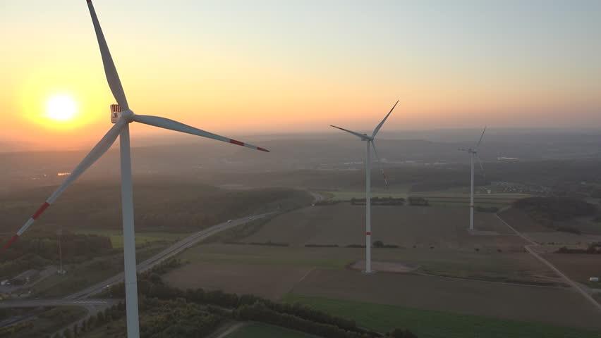 4K. Aerial shot of Power Generating Windmills. Wind turbines producing clean renewable energy. - 4K stock video clip