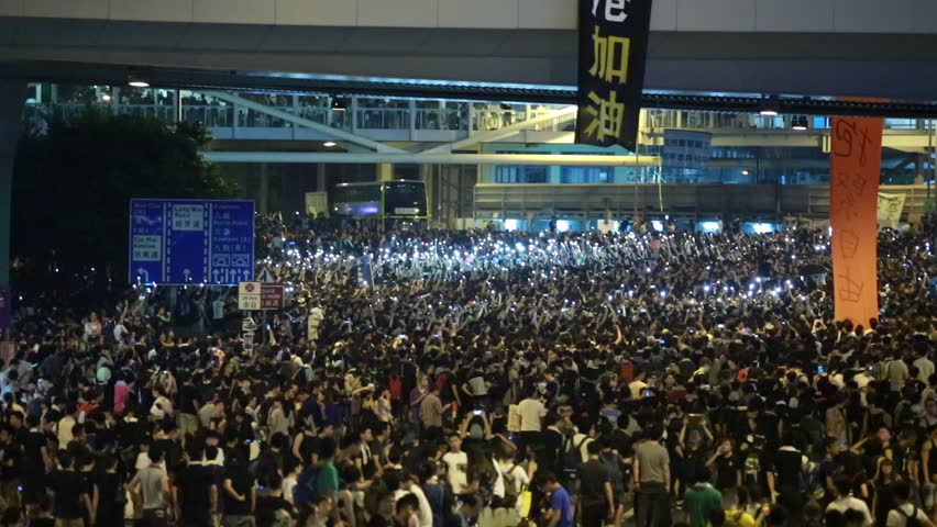 HONG KONG, SEPT.29: protesters occupy the road near government headquarter in Admiralty on 29 September 2014. after riot police fire tear shell to the peaceful protesters ,people join the protest