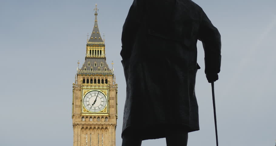 Proud to be British. Iconic Prime Minister Winston Churchill faces Big Ben. London. June 2014.