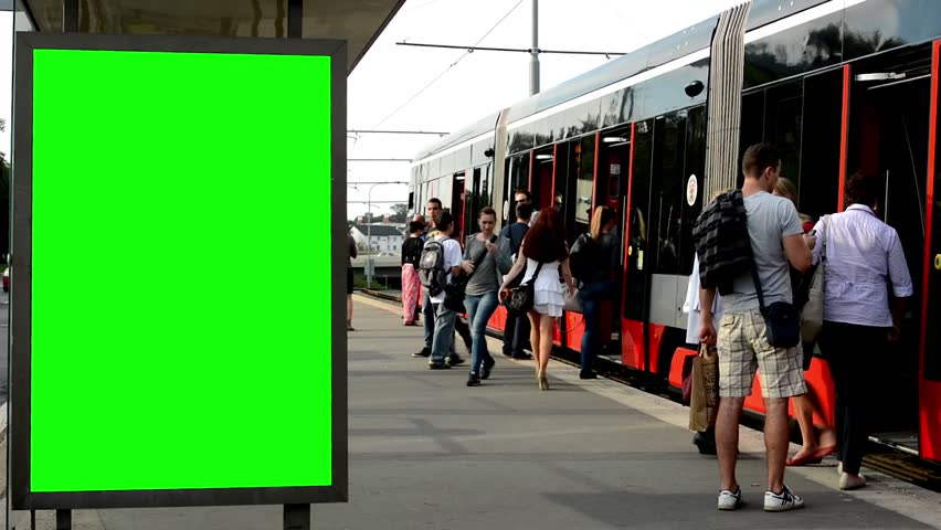 CZECH REPUBLIC, PRAGUE - SEPTEMBER 19, 2014: billboard in the city near road and buildings - green screen - commuter people - tram