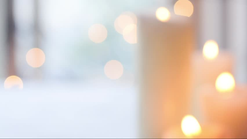Holiday background, defocused candle lights, moving bokeh