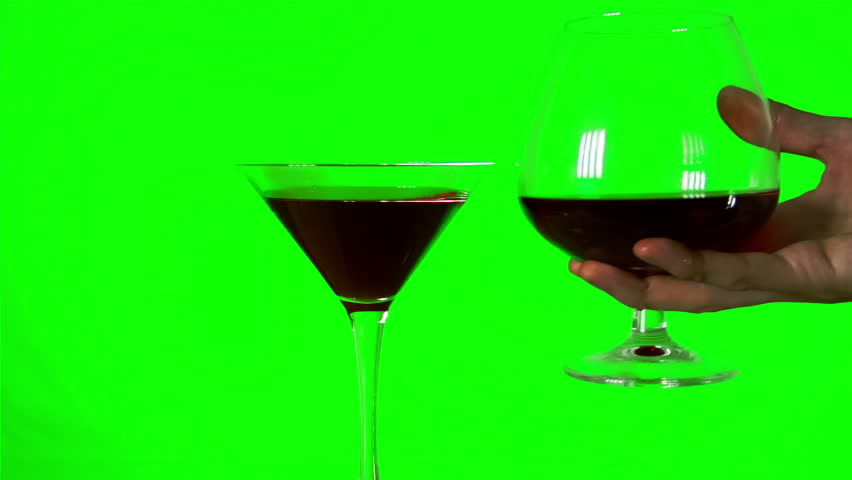 clink glass of wine with a wine glass on the green screen background.