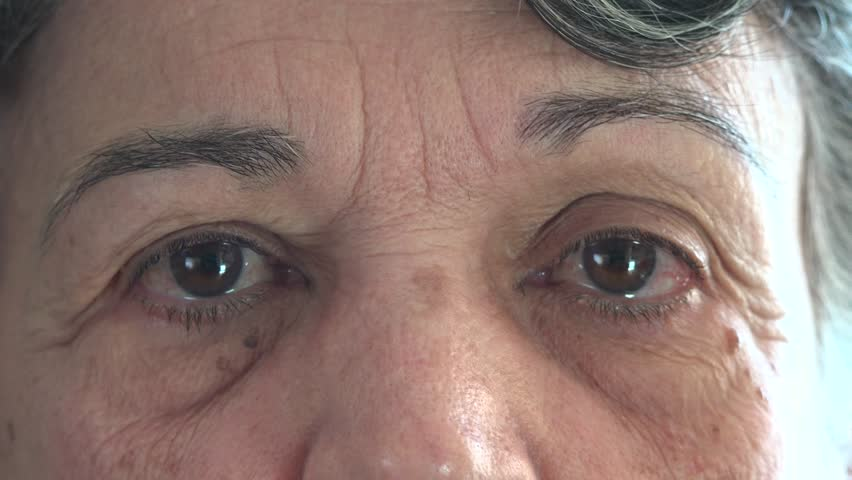 Eyes of a senior woman looking in different directions, close up of a wrinkled face with eyes moving.