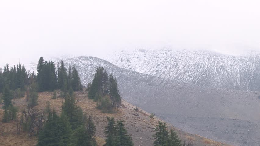 Snow storm rolls in on the pacific northwest cascade mountain range