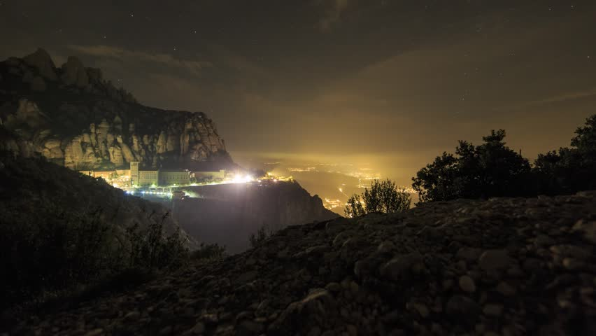 Mountain and Monastery at Montserrat, just before sunrise, timelapse footage with dolly movement. Catalonia, Spain.
