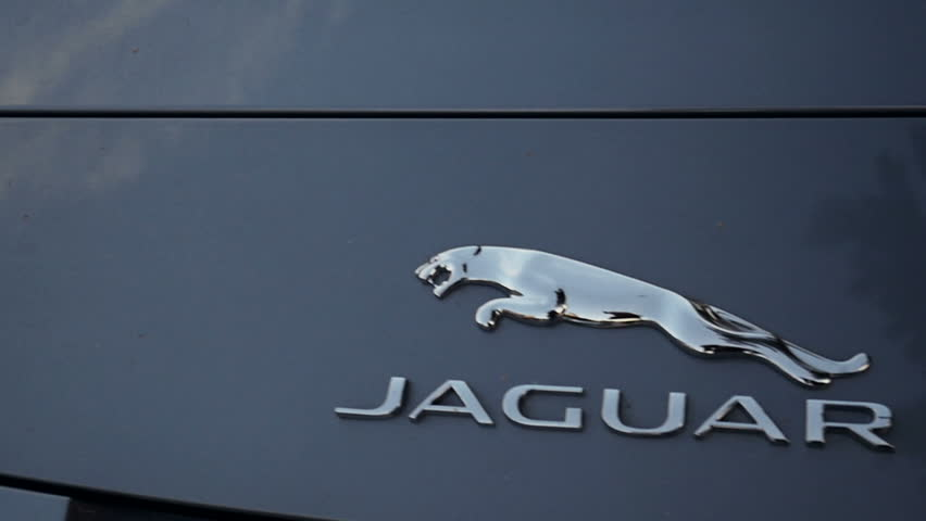 LONDON, UNITED KINGDOM - NOVEMBER 8, 2014:  Jaguar Motors car logotype slow panning  on the streets of Maranello on Apr 24. Panning left to right. Jaguar Cars is a brand of Jaguar Land Rover