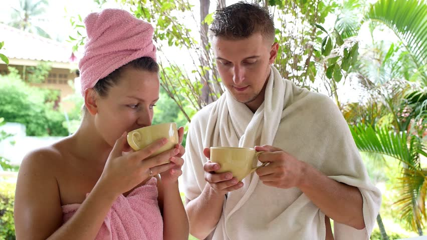 Couple Talking and Drinking Coffee after Shower in the Morning. HD, 1920x1080. - HD stock video clip