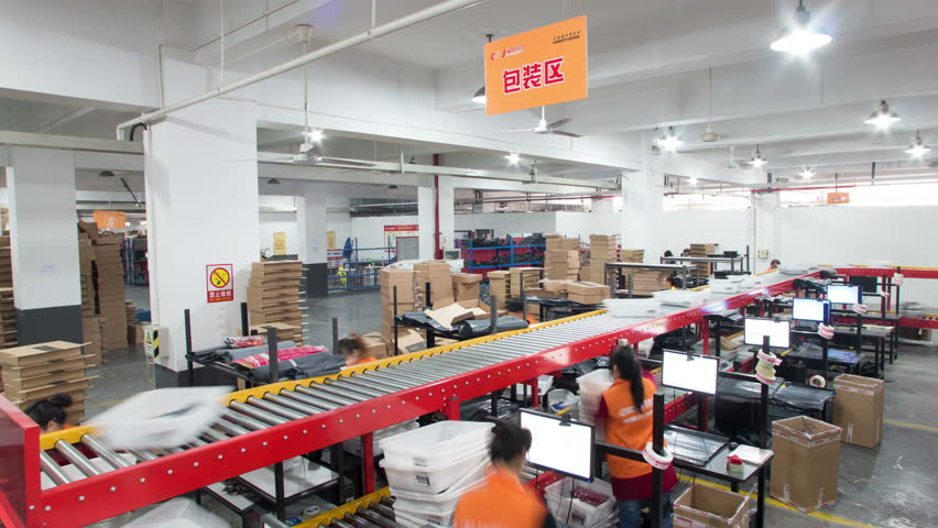 Hangzhou,China-November 12,2014:Express delivery packaging and sorting assembly line in processing,time-lapse. The prosperity of e-business has boomed Chinese express delivery industry. 4k format.