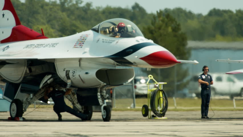"""BELLEVILLE, MI, USA – AUGUST 2014:  F-16 Fighting Falcon piloted by a member of the US Air Force """"Thunderbirds"""" display team, waits in the heat haze of a summer day.  Recorded in 4K, UHD."""