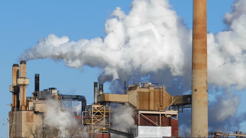 Factory Smoke Stacks Belch Thick Smoke into the Sky