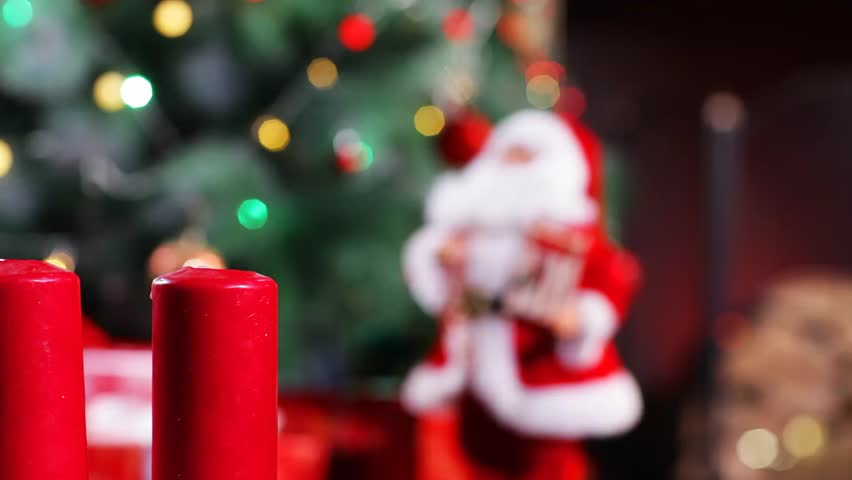 Set Afire of Candles beside a  Christmas tree