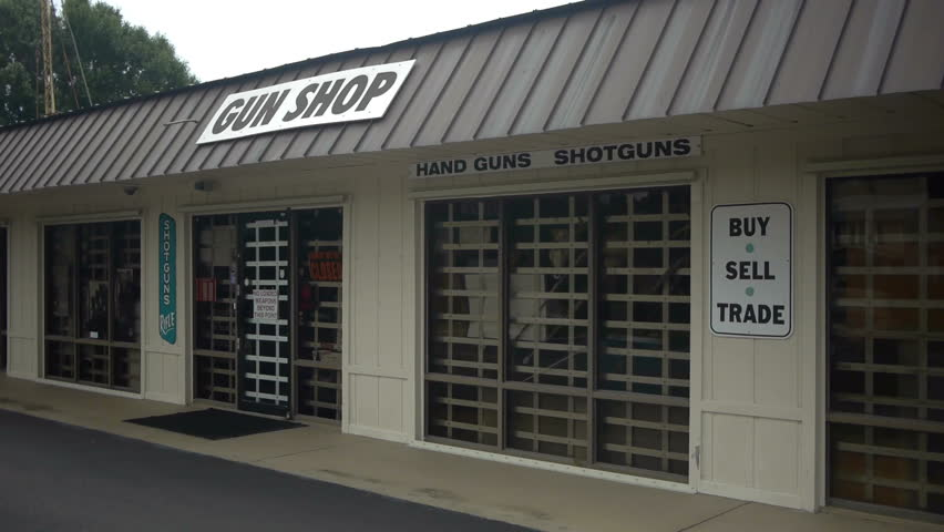Vero Beach, Florida, July 2012. Closed gun shop by the road, with signs saying 'Gun shop. We trade, buy sell'