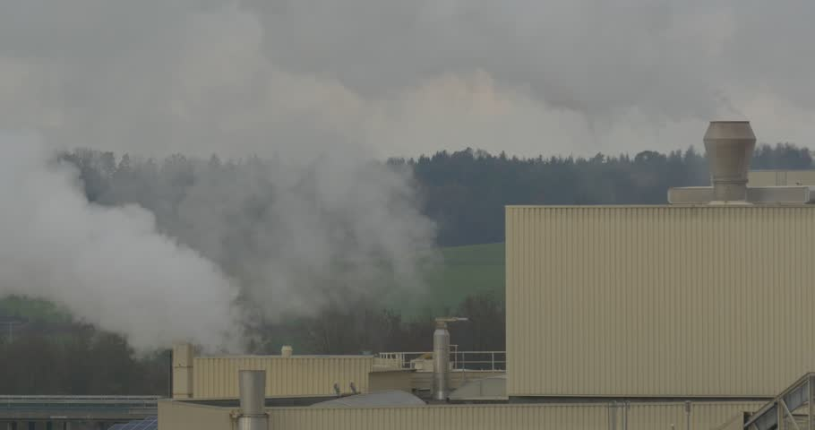 Chemical factory with smoke stack, air pollution - 4K stock video clip