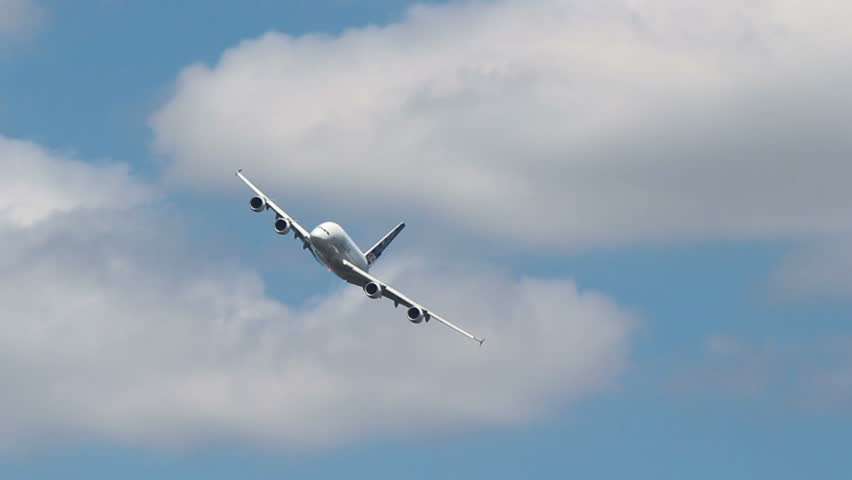 FARNBOROUGH, UK – JULY 17, 2014: Airbus A380 performing a left banked turn.