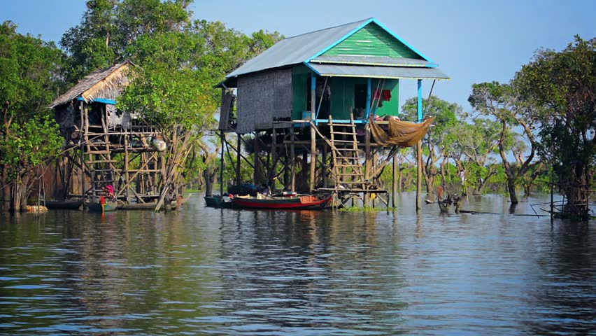 River Houses On Stilts Built Directly In A Wide River In