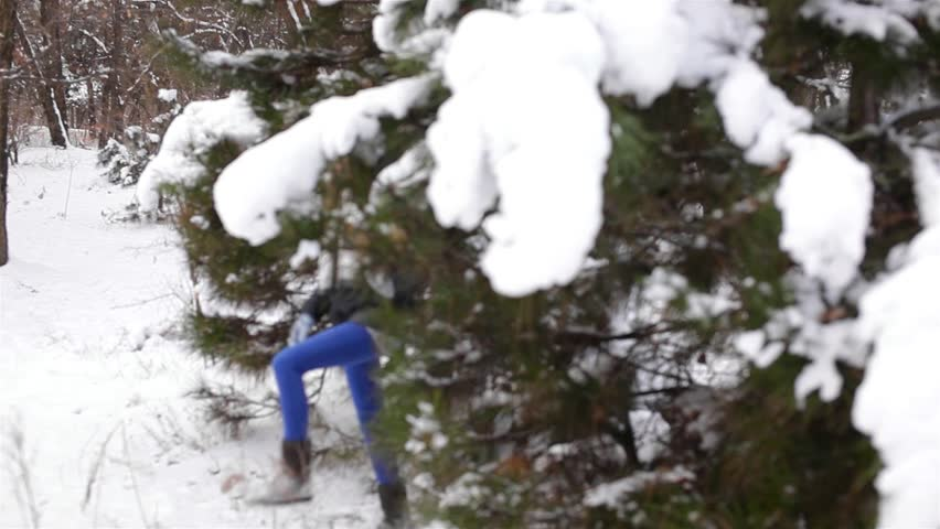 Young woman walking in winter forest - HD stock video clip