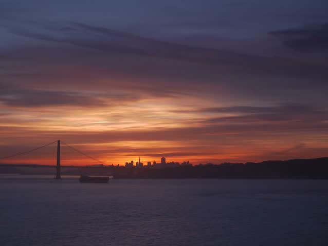 Marin Headlands, California - November, 2014 - Timelapse of the sunrise over a silhouette of the Golden Gate Bridge.
