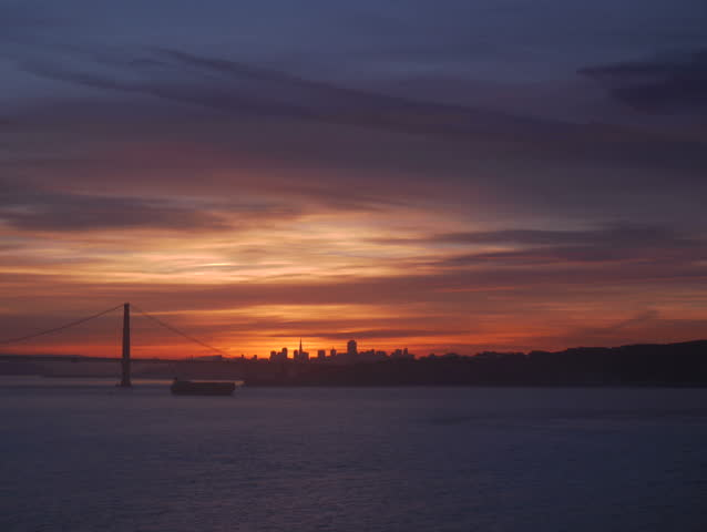 Marin Headlands, California - November, 2014 - Timelapse of the sunrise over a silhouette of the Golden Gate Bridge.