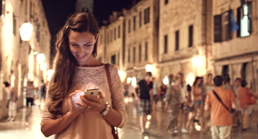 Beautiful Happy Woman Tourist Using Smartphone Tablet Vacation Tourism Application App Texting Sms Smiling Technology 3G 4G High Speed Wi-Fi Everywhere Uhd 4K
