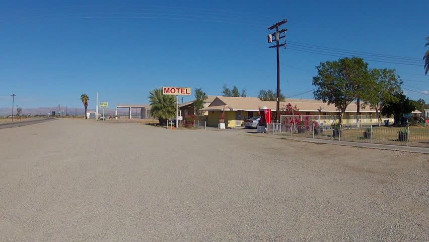 Wide Shot Of An Old Fashioned Generic Motel On A Desert