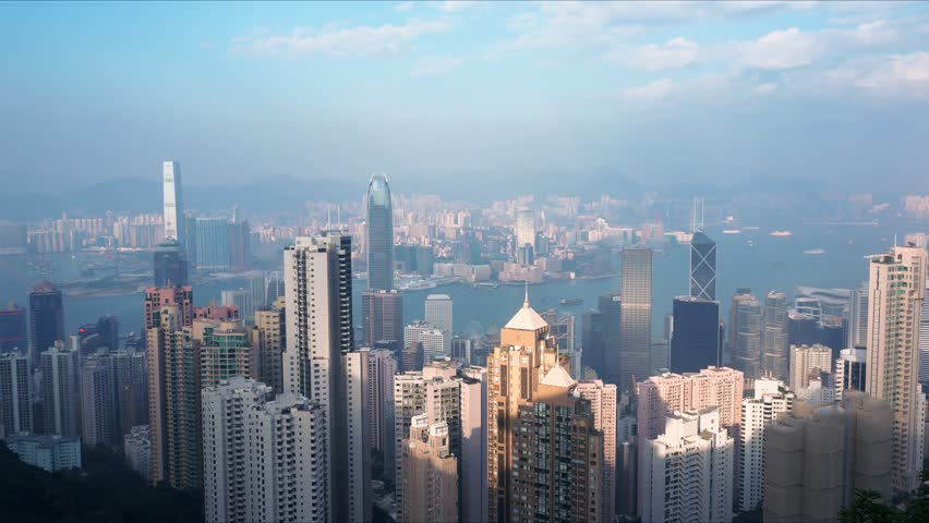 4K time lapse video of day view at Hong Kong city skyline from Peak View.