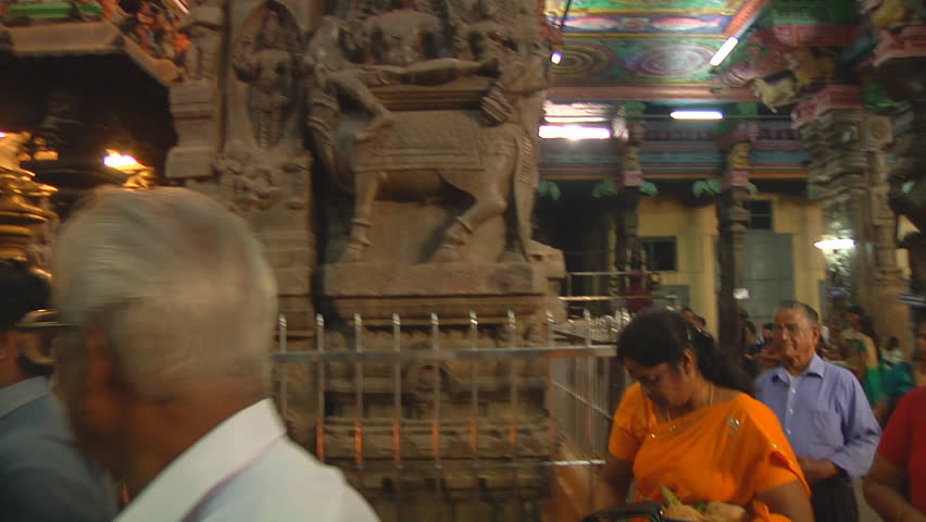 MADURAI - CIRCA 2014: Mid Shot of crowds of people inside the temple at Meenakshi Amman Temple circa 2014 in Madurai, Tamil Nadu, India. - HD stock footage clip