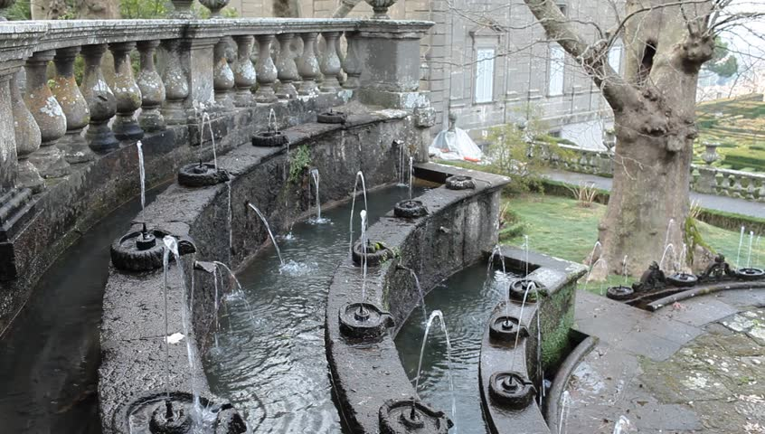 The Fountain Of The Lamps circular tiered fountain with smaller fountains,imitating Roman oil lamps,spout small jets of water which in the sunlight appear to blaze like lamp flames.Villa Lante, Italy.