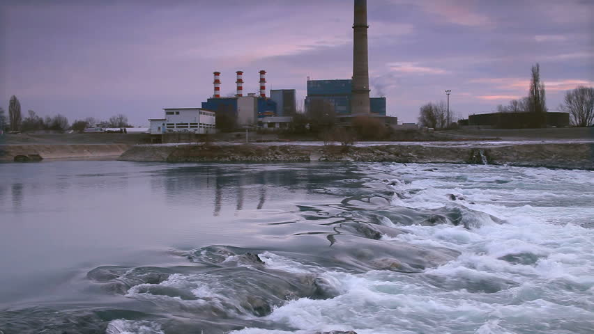 water flow to waterfall and factory in background - HD stock video clip