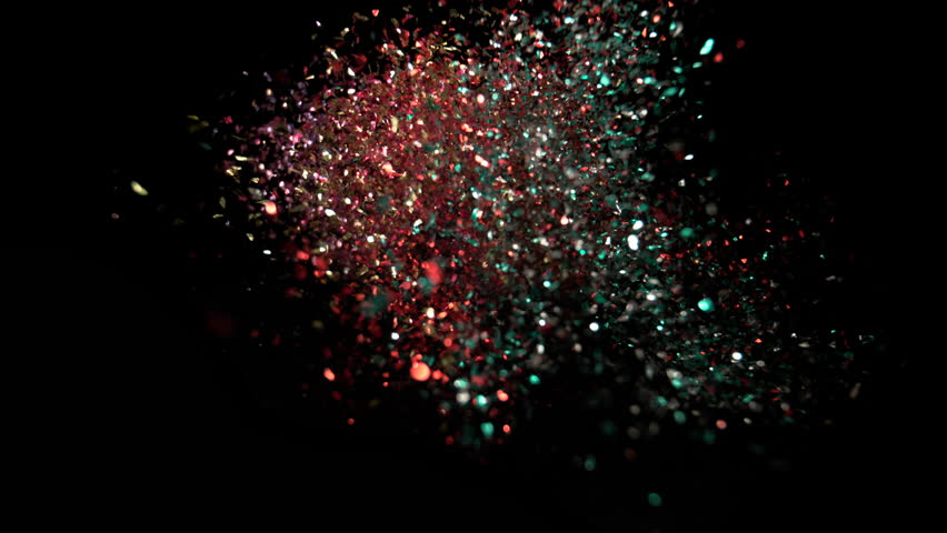 Camera follows colorful confetti flying after being exploded against black background. Shot with high speed camera, phantom flex 4K. Slow Motion. Unedited version is included at the end of clip.