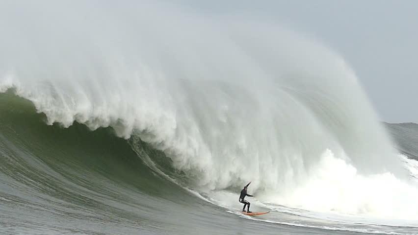 Half Moon Bay, California, USA - Dec. 20, 2014: Big wave surfer, Tyler Fox, rides a giant wave at Mavericks surf break.