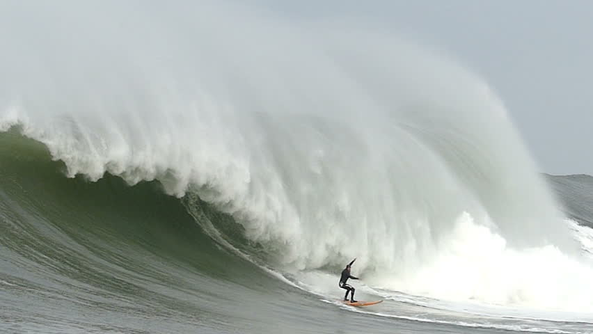 Half Moon Bay, California, USA - Dec. 20, 2014: Big wave surfer, Tyler Fox, rides a giant wave at Mavericks surf break.