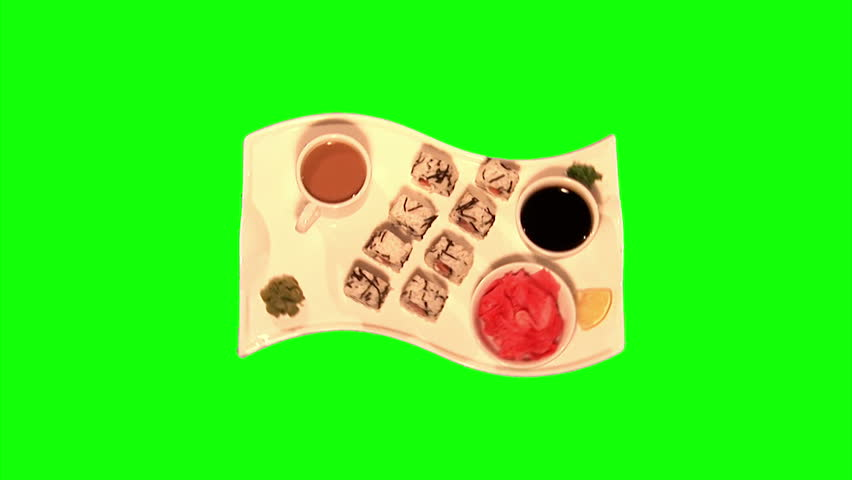 Sushi – rice, smoked salmon, tomato, cream cheese, celery (Chinese) cabbage, ginger, soy sauce and coffee on tray rotating on green screen, loop, top shot  - HD stock footage clip