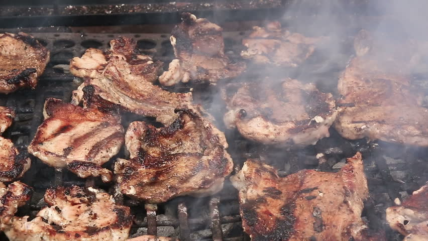 Steaks and ribs on barbecue grill
