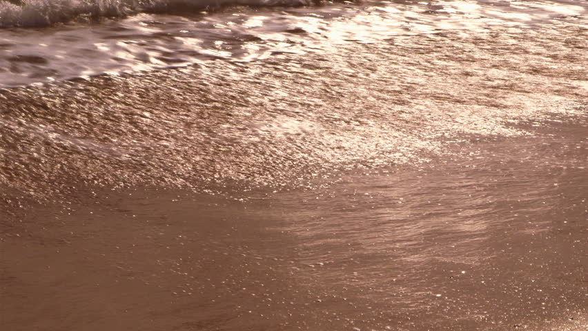 Waves Lapping on the Beach  - HD stock video clip