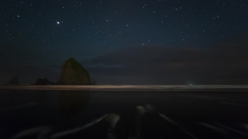 Time Lapse of Starry Night by the Haystack Rock at Cannon Beach, Oregon.
