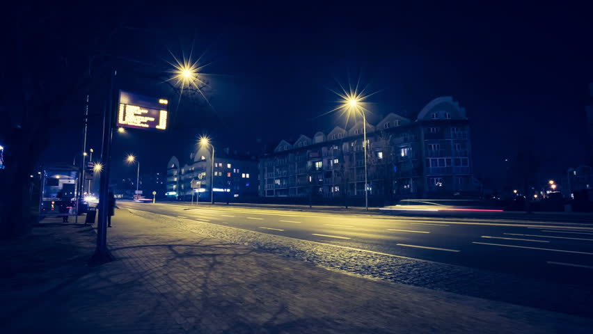 OLSZTYN - FEBRUARY 18, (Timelapse View with vintage mood). Bus station on Tomasza Wilczynskiego Street. Typical view on polish bus station at night