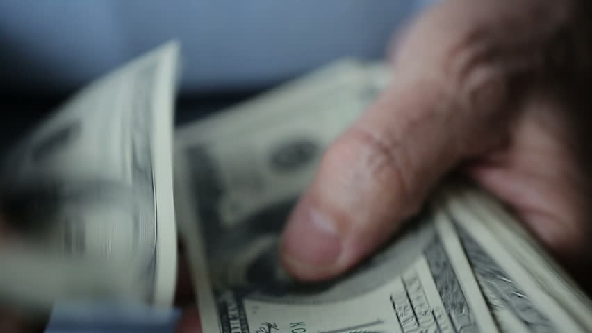 A businessman's hands counting hundred dollar bills at a table - HD stock video clip