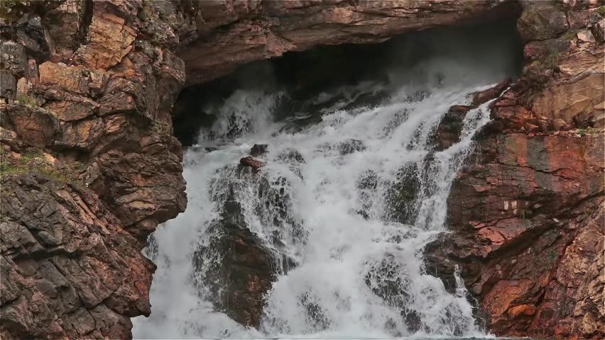 Running Eagle Falls in first snowfall,Glacier National park , Montana