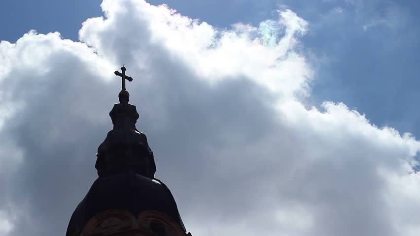 A cathedral church cross in shaddows, oriented towards big sky and God. - HD stock video clip