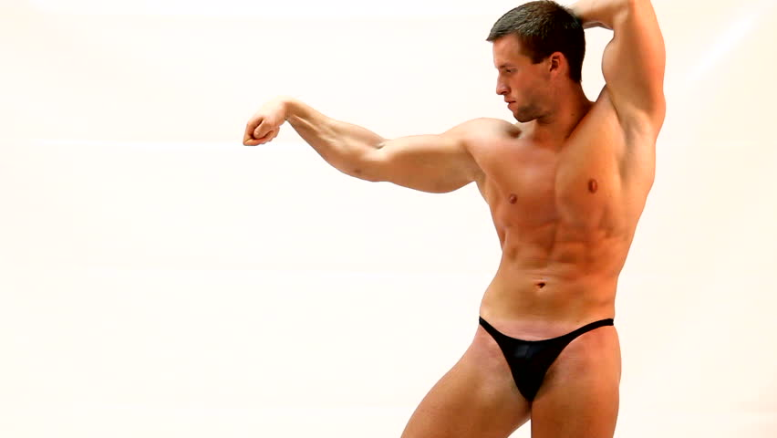 bodybuilder flexing his muscles - HD stock footage clip