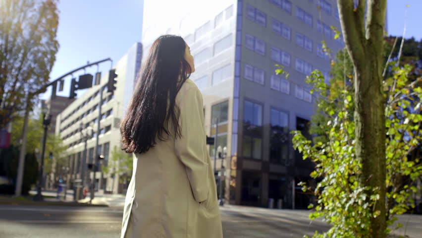 Mixed Race Young Woman Walks Around City, Beautiful Light