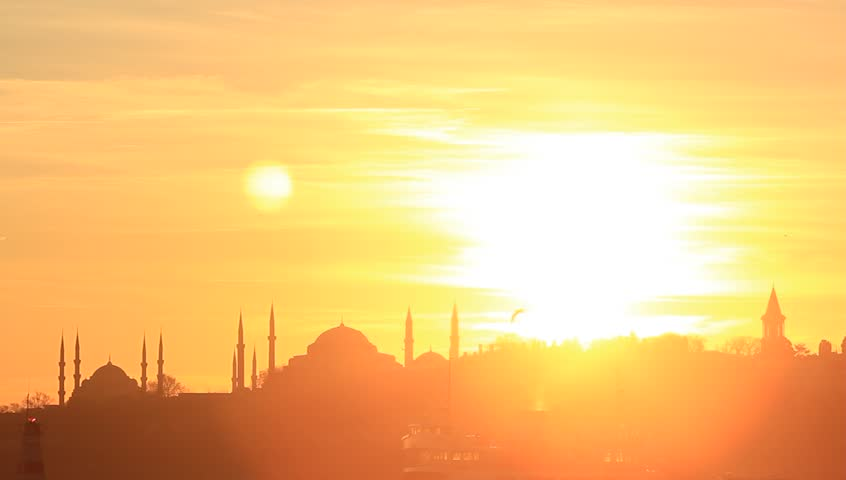 Sun shines like crazy just before the sky gets dark again over historical peninsula in Istanbul. In the distance are such landmarks as Blue Mosque, Hagia Sophia and Topkapi Palace over Sarayburnu