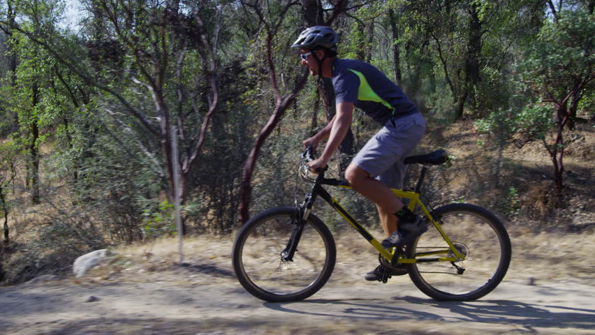 Man riding mountain bike in nature
