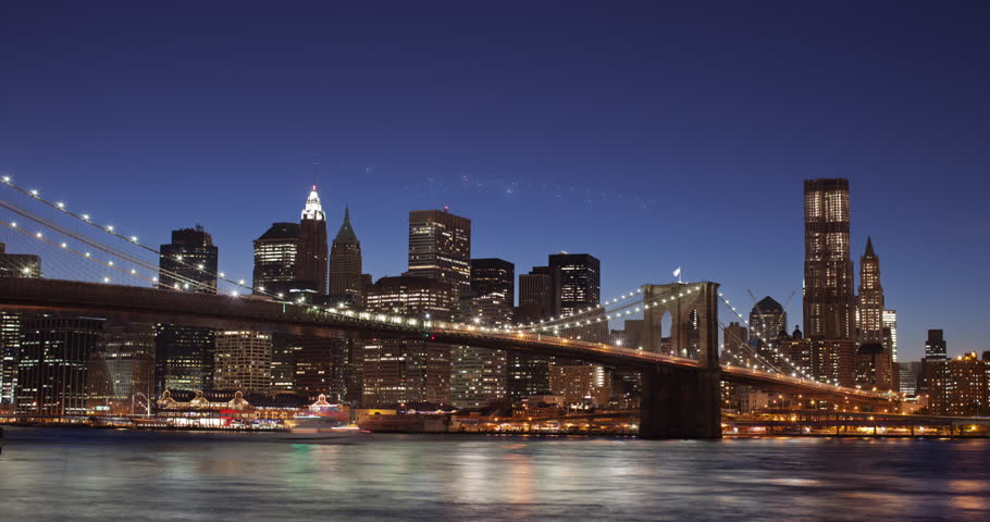New York City timelapse of Midtown and Downtown Manhattan at sunset with the  Brooklyn Bridge, Empire State Building, Chrysler building and Pier 17 in shot.